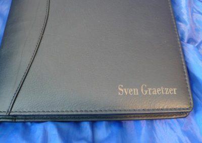 Ihr Name auf Ihrem Notizbuch